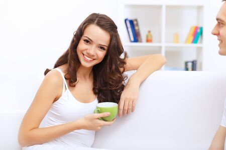 Portrait of lovely young woman having cup of tea at home Stock Photo - 15006661