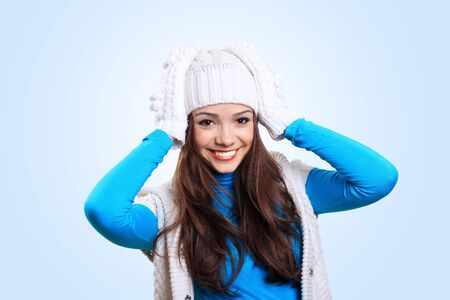winter woman: Young pretty woman with lomng hair wearing warm pullover Stock Photo