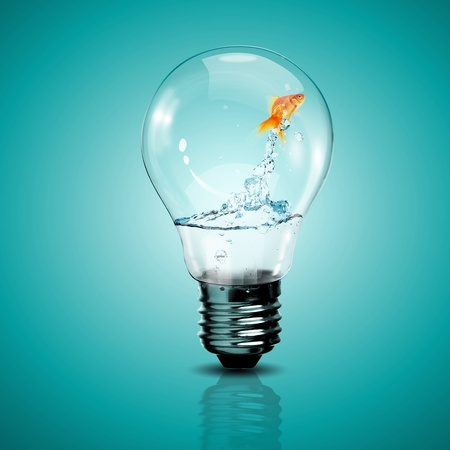 innovation concept: Gold fish in water inside an electric light bulb