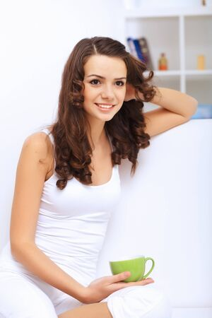 Portrait of lovely young woman having cup of tea at home Stock Photo - 15006717
