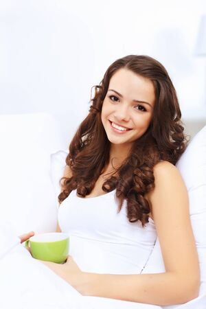 Portrait of lovely young woman having cup of tea at home Stock Photo - 15006710