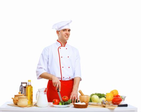 garnishing: Young cook preparing food wearing a red apron