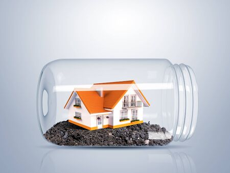 Residential house with red roof inside glass jar Stock Photo - 15008482