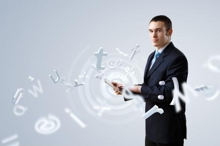 presenter: Businessman making presentation against modern technology background