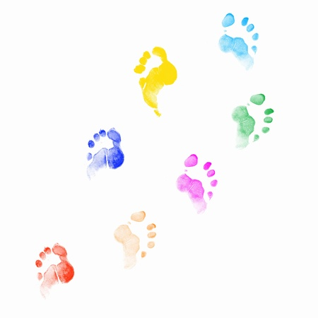 impression: Colourful human foot prints on white background