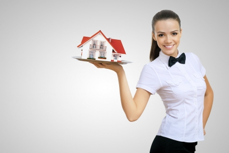 Waitress in white shirt with a tray and house on it photo