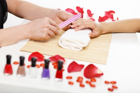 Young woman is getting manicure in a beauty salon Stock Photo - 15493715
