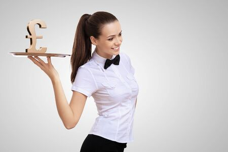 Waitress holding a tray with money on it photo