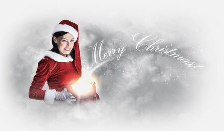 Portrait of beautiful girl wearing santa claus clothes on red background Stock Photo - 15483223