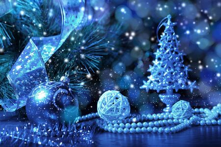 cristmas: Blue Christmas collage  Decorations and ribbons on a blue background