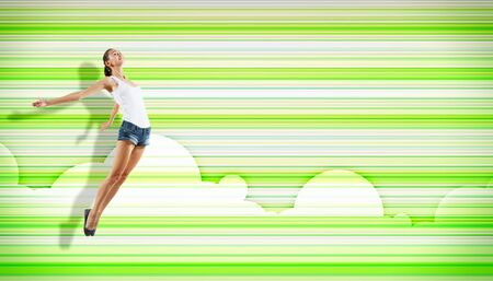 pretty modern slim hip-hop style woman jumping dancing on a colour background photo