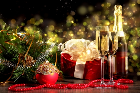 cristmas: New Year s collage with glasses of champagne  Decorations and ribbons on a bright color background