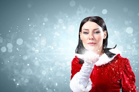 Portrait of beautiful girl wearing santa claus clothes on red background Stock Photo - 15538124