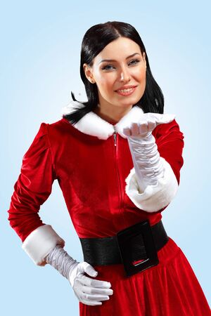 Santa Girl presenting your product, in costume and white gloves Stock Photo - 15464401