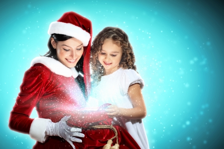Christmas illlustration of little girl with christmas gifts and santa Stock Photo - 15584740