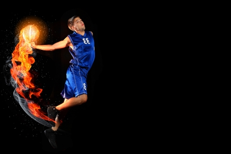 Male basketball player jumping and practicing with a ball Stock Photo - 15455600