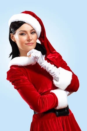 Santa Girl presenting your product, in costume and white gloves photo