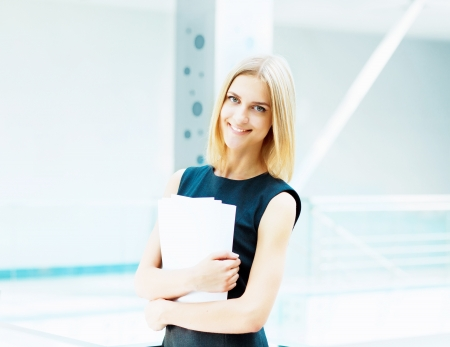 A portrait of a young business woman in an office Stock Photo - 15455629