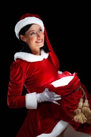 Santa Girl presenting your product, in costume and white gloves Stock Photo - 15539330