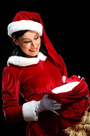Santa Girl presenting your product, in costume and white gloves Stock Photo - 15539359