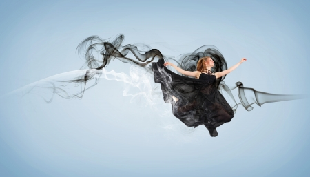 Beautiful young dancer with black smoke curles around her Stock Photo - 15539233