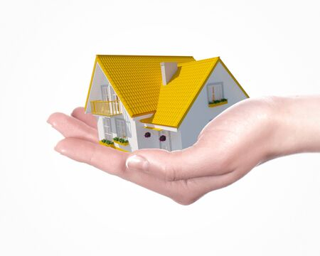 The house with colour roof in human hands Stock Photo - 15539381