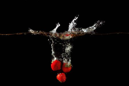 Colored red paprika in water splashes on black background Stock Photo - 15539256