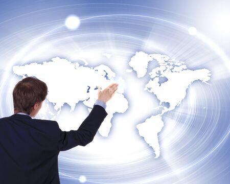 Modern Business World, A businessman navigating virtual world map Stock Photo - 15539425