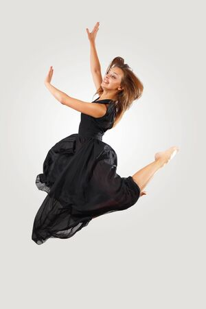 Young female dancer jumping against white background Stock Photo - 15539212