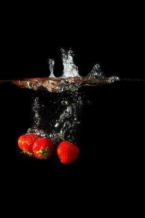 Colored red paprika in water splashes on black background Stock Photo - 15539294
