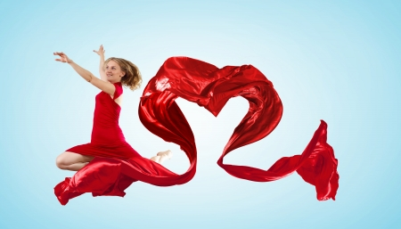 Young woman dancing with red fabric in studio and heart symbol Stock Photo - 15539235