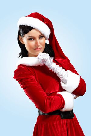 Santa Girl presenting your product, in costume and white gloves Stock Photo - 15539343