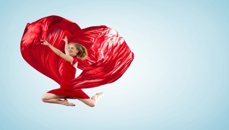 Young woman dancing with red fabric in studio and heart symbol Stock Photo - 15539230