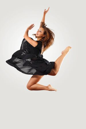 Young female dancer jumping against white background Stock Photo - 15539217