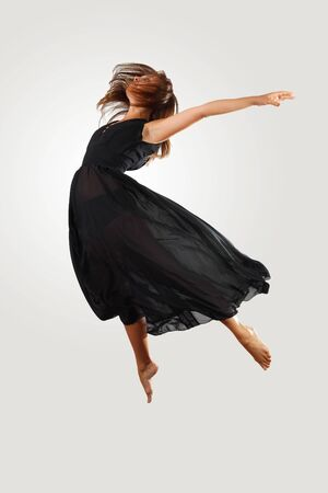 Young female dancer jumping against white background Stock Photo - 15539207