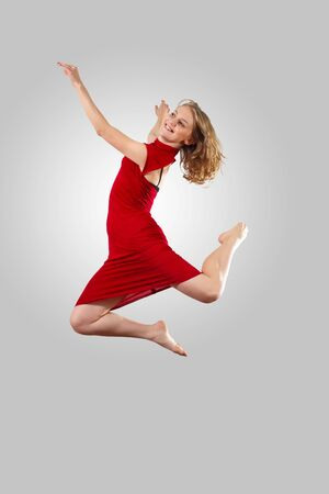 Young female dancer jumping against white background Stock Photo - 15539131