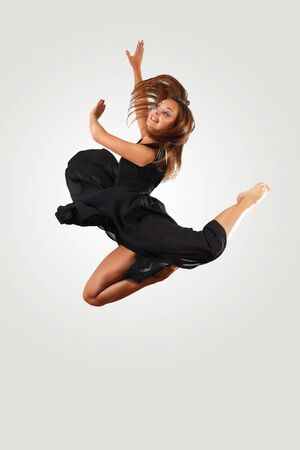 Young female dancer jumping against white background Stock Photo - 15539161