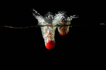 Colored red paprika in water splashes on black background Stock Photo - 15539264