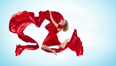 Young woman dancing with red fabric in studio and heart symbol Stock Photo - 15539247