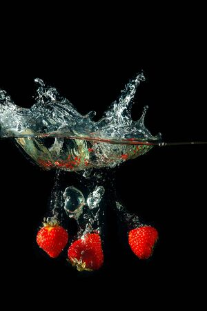 Colored red paprika in water splashes on black background Stock Photo - 15539332