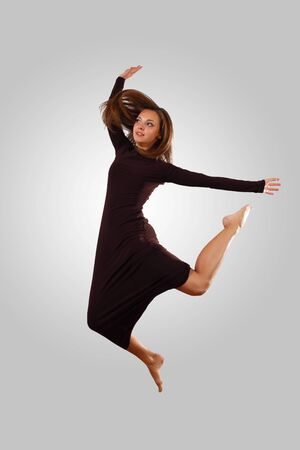Young female dancer jumping against white background Stock Photo - 15539135