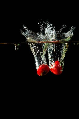 Colored red paprika in water splashes on black background Stock Photo - 15539307