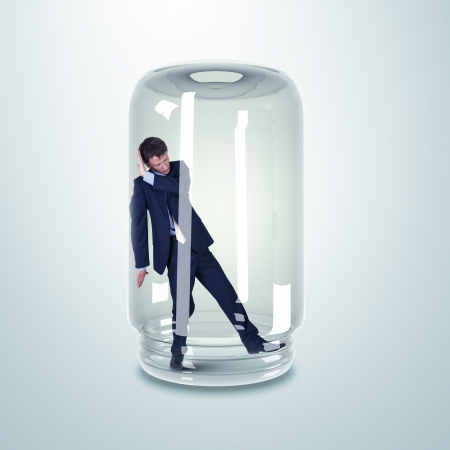 scared man: Businessman trapped inside a transparent glass jar