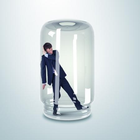 hombre asustado: Hombre de negocios atrapado en un frasco de vidrio transparente Foto de archivo