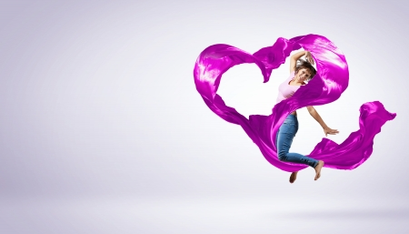 Young woman dancing with red fabric in studio and heart symbol Stock Photo - 15539178