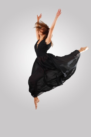 Young female dancer jumping against white background Stock Photo - 15539169
