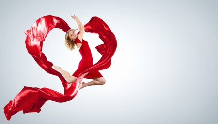 Young woman dancing with red fabric in studio and heart symbol Stock Photo - 15539180