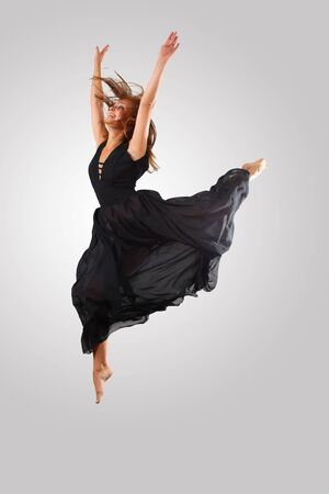 Young female dancer jumping against white background Stock Photo - 15539153
