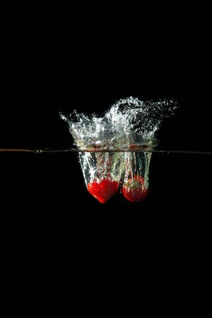 Colored red paprika in water splashes on black background Stock Photo - 15539254