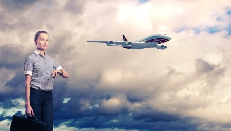 corporate airplane: Busines person and plane on the background against cloudy sky Stock Photo